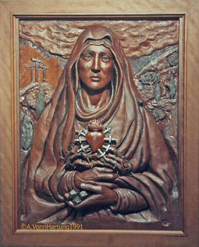 """La Madre Dolorosa"" (Sorrowful Mother) wood sculpture (high relief) by AVonnHartung for Casa de Niños Manuel Fernandez Juncos (Miramar SJ, Puerto Rico"