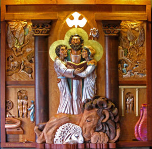 """Holy Family"" is a high relief wood sculpture by AVonnHartung for private collection"