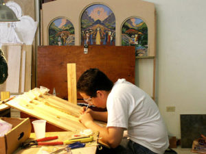 """GiovanniDiazJimenez, our first volunteer, cuts tiles for MosicMural """"The Life and Prophecy of St. John the Baptist"""" in Orocovis. He is now a seminarian studying in Navarra,Spain"""
