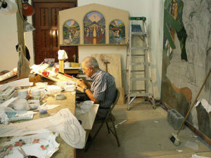 """Padre Demetrio Coello, SDB cuts tiles for MosaicMural """"The Life and Prophecy of St. John the Baptist"""" in Orocovis, Puerto Rico. He spent many hours working on this project particularly on the figure of St. Peter"""